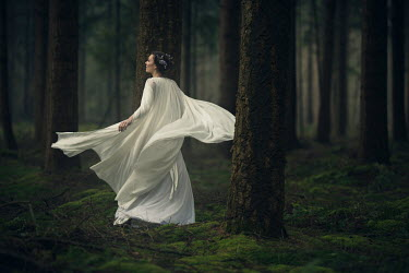 Patrick Den Drijver WOMAN IN WHITE IN FOREST AT DUSK Women