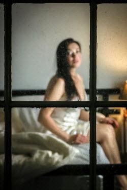 Stephen Carroll ANXIOUS WOMAN ON BED BY WINDOW Women