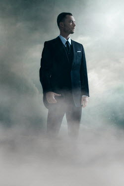 Ysbrand Cosijn MAN IN SUIT STANDING IN FOG Men