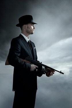 Ysbrand Cosijn CLOSE UP OF RETRO MAN WITH GUN Men