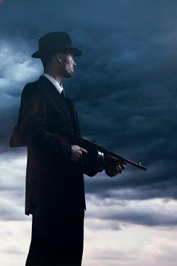 Ysbrand Cosijn RETRO MAN IN SUIT HOLDING GUN IN STORM Men