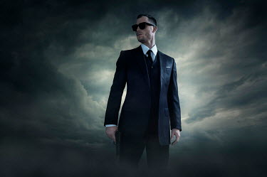 Ysbrand Cosijn MAN IN SUIT AND SUNGLASSES IN STORM Men