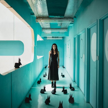 Dasha Pears WOMAN IN CORRIDOR WITH PAPER RABBITS Women