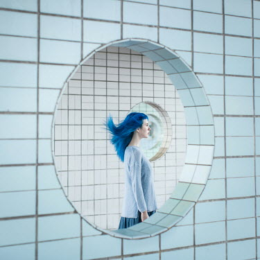 Dasha Pears WOMAN WITH BLUE HAIR IN FUTURISTIC BUILDING Women