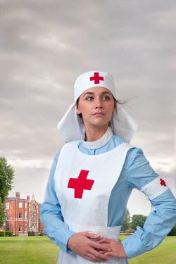 Lee Avison HISTORICAL NURSE STANDING OUTSIDE HOSPITAL Women