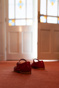 Peter Chadwick CHILD'S RED SHOES IN HOUSE BY DOOR Miscellaneous Objects