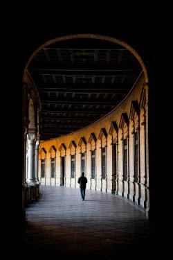 Evelina Kremsdorf MAN WALKING IN HISTORICAL BUILDING Men