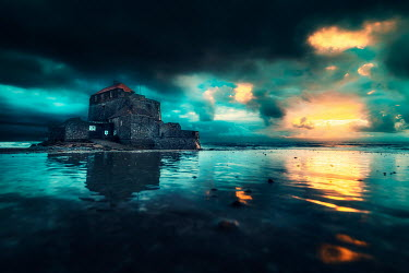 David Keochkerian OLD BUILDING ON ISLAND AT SUNSET Houses
