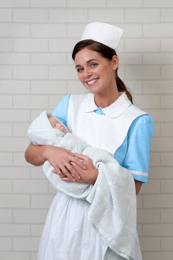 Lee Avison HAPPY RETRO NURSE HOLDING BABY Women