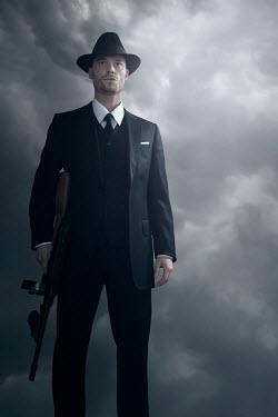 Ysbrand Cosijn RETRO MAN HOLDING GUN WITH STORMY SKY Men