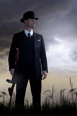 Ysbrand Cosijn RETRO MAN CARRYING GUN OUTDOORS Men