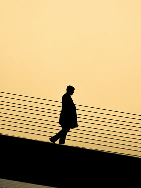 Elisabeth Ansley SILHOUETTE OF MAN ON BRIDGE Men