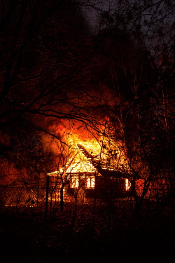 Magdalena Russocka wooden house on fire Houses