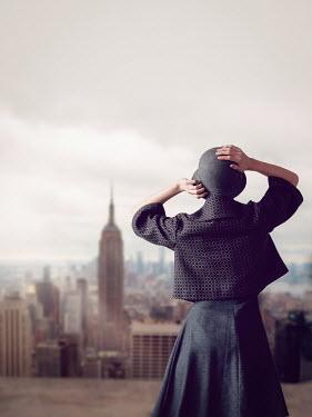 Elisabeth Ansley RETRO WOMAN WATCHING NEW YORK SKYLINE Women