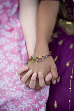 Lee Avison asian and caucasian girls holding hands Children