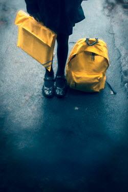 Lee Avison school girl with yellow rucksack and book bag