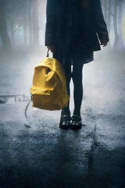 Lee Avison schoolgirl carrying a yellow rucksack Children