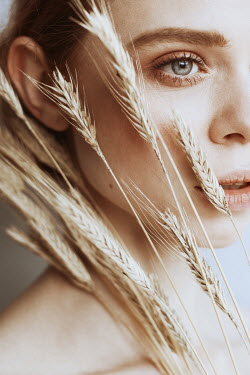 Dorota Gorecka CLOSE UP OF FEMALE FACE WITH WHEAT Women