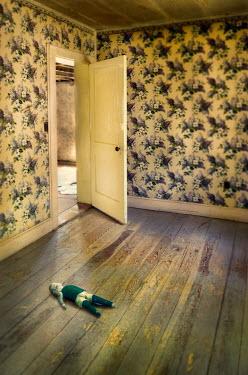 Jill Battaglia DOLL LYING IN ABANDONED HOUSE Interiors/Rooms