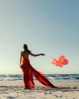 Dorota Gorecka WOMAN WITH BALLOONS ON WINDY BEACH Women
