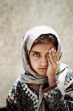 Mohamad Itani MIDDLE EASTERN GIRL IN SHAWL COVERING EYE Children