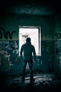 Mohamad Itani MAN IN DERELICT BUILDING FROM BEHIND Men