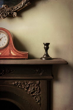 Peter Chadwick CLOCK AND CANDLESTICK HOLDER ON MANTLEPIECE Interiors/Rooms