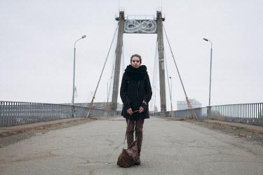 Dmitriy Bilous WOMAN STANDING ON DERELICT BRIDGE Women
