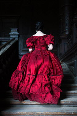 Magdalena Russocka historical woman running up stairs in grand building Women