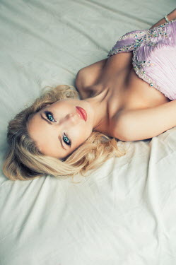 Mohamad Itani BLONDE WOMAN LYING ON BED IN GOWN Women