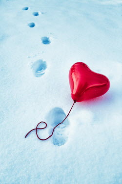 Magdalena Russocka red heart shaped balloon left on snow
