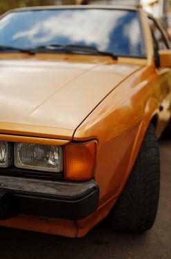 Svitozar Bilorusov CLOSE UP OF BROWN RETRO CAR Cars