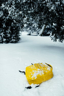 Magdalena Russocka yellow rucksack dropped on snow