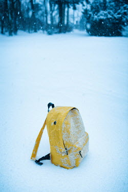 Magdalena Russocka yellow rucksack left on snow