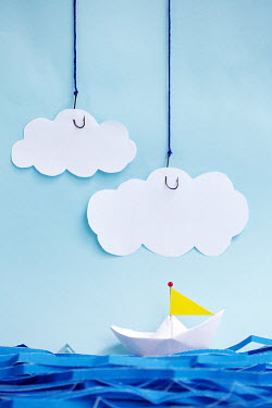 Alison Archinuk PAPER BOAT ON SEA WITH CLOUDS ON HOOKS Miscellaneous Objects