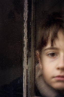 Galya Ivanova little sad boy behind rainy window Children