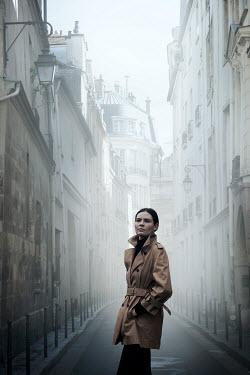 Miguel Sobreira WOMAN IN COAT IN HISTORICAL STREET Women
