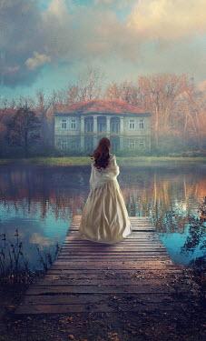Drunaa Woman looking at  house on lake Women