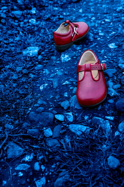 Stephen Mulcahey Child's red shoes on stony path Miscellaneous Objects