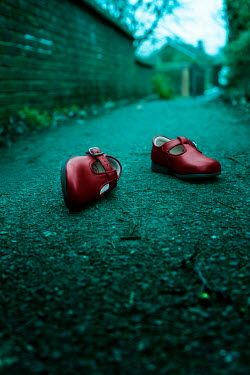 Stephen Mulcahey Childs red shoes left behind in  an alleyway