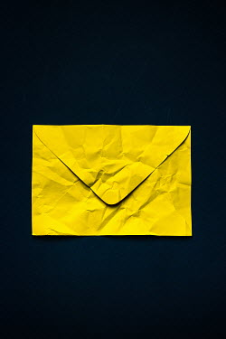 Magdalena Russocka close up of creased yellow envelope Miscellaneous Objects