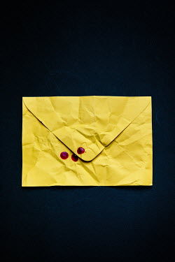 Magdalena Russocka close up of yellow envelope with blood Miscellaneous Objects