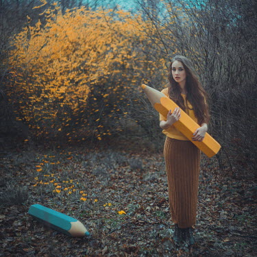 Anya Anti WOMAN HOLDING GIANT YELLOW CRAYON Women