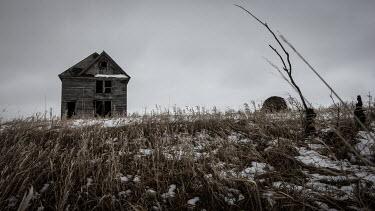 Rodney Harvey DERELICT WOODEN HOUSE IN WINTRY FIELD Houses