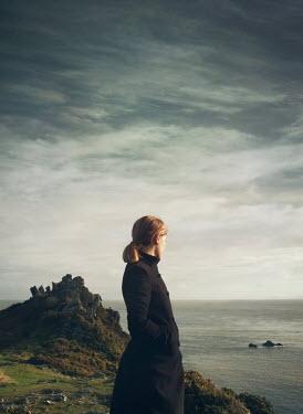 Mark Owen BLONDE WOMAN ON CLIFF WATCHING SEA Women