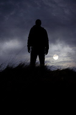 Laura Ranftler SILHOUETTED MAN IN FIELD WITH MOON Men
