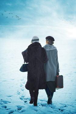 Ildiko Neer Two vintage women walking in snow Women