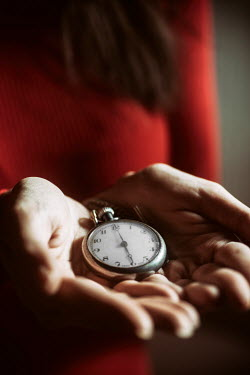 Mohamad Itani WOMAN HOLDING SILVER FOB WATCH Women