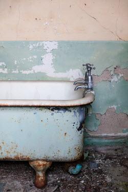 David Baker OLD RUSTY BATH IN DERELICT HOUSE Interiors/Rooms