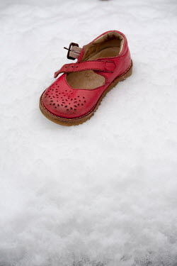 Lee Avison CHILD'S RED SHOE LYING ON SNOW Miscellaneous Objects